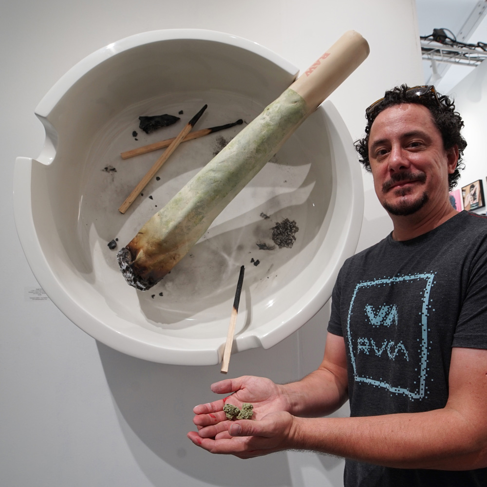Sergio Garcia with his sculpture for Thinkspace Gallery's Scope booth.